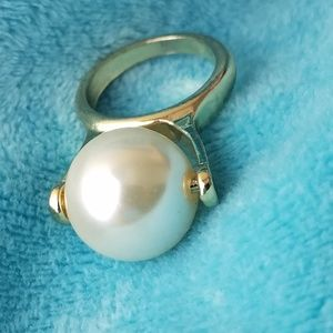 Big pearl and golden statement ring